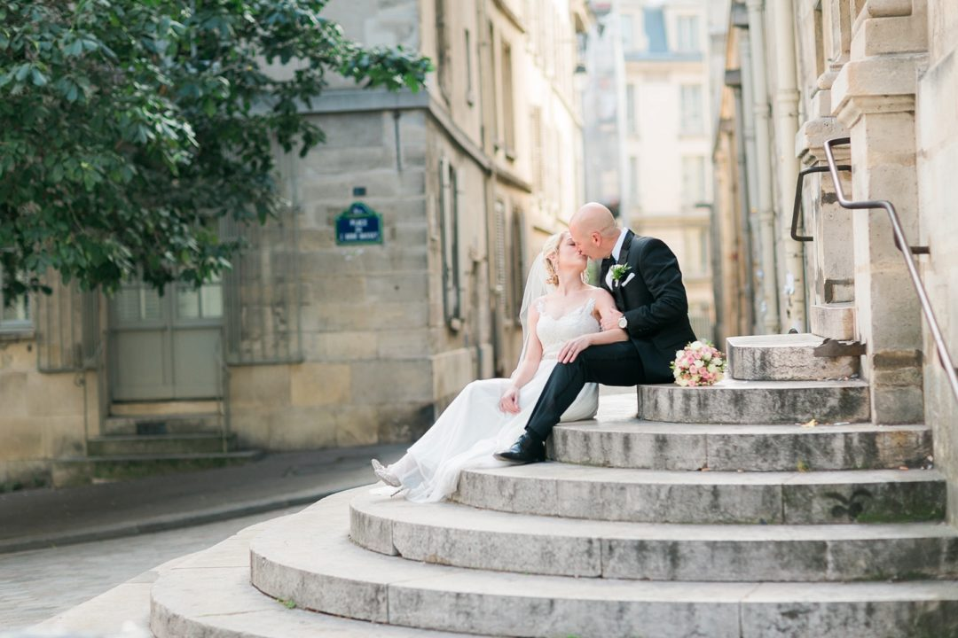 Paris wedding elopement photographer Fine art film Eiffel Tower romantic wedding gown dress bridal bouquet hair makeup